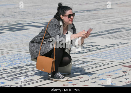 Blackpool Lancashire. 1st May, 2018. UK Weather:  Sunny start to the day on the Fylde Coast. Foreign tourists enjoy the attractions on the seafront promenade.  The comedy carpet or pavement provides a comic backdrop for photographers intent on taking selfies. MediaWorldImages/AlamyLiveNews. Stock Photo