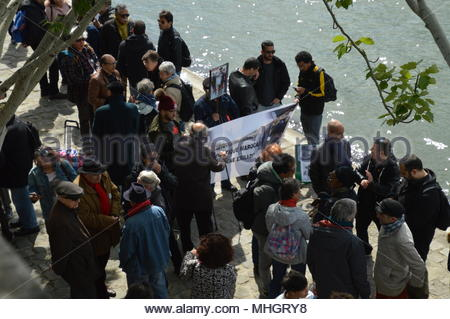 Paris, France. 1st May, 2018. People gather during a tribute ceremony to Brahim Bouarram, a Moroccan who drowned in 1995 when right-wing extremists threw him from a bridge after a National Front rally, during a ceremony a tribute ceremony on the banks of the Seine River in Paris, France, on May 1, 2018. (c) copyright Credit: CrowdSpark/Alamy Live News - Stock Photo