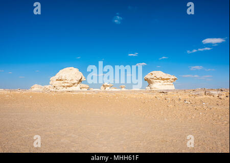 Mushroom rock formations at the Western White Desert of Egypt - Stock Photo