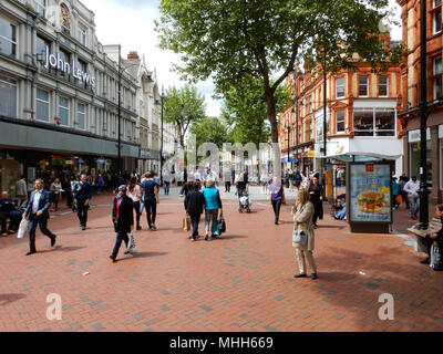 Reading, England - May 18 2017:   Crowds of shoppers in Broad Street, the main shopping road in Reading - Stock Photo