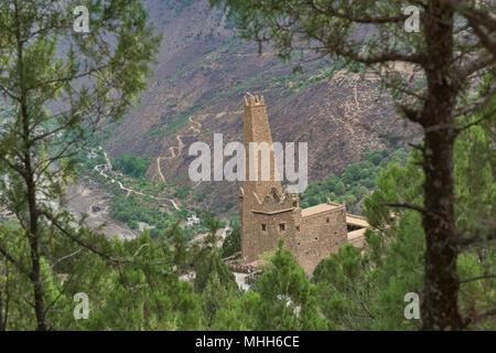 Ancient Qiang stone watchtower in the Tibetan village of Jiaju, Sichuan, China - Stock Photo