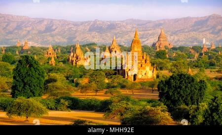 Sunrise landscape view of beautiful old temples in Bagan, Myanmar (Burma) - Stock Photo