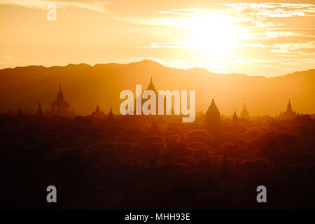 Beautiful sunset landscape view with ancient temples at Bagan, Myanmar - Stock Photo