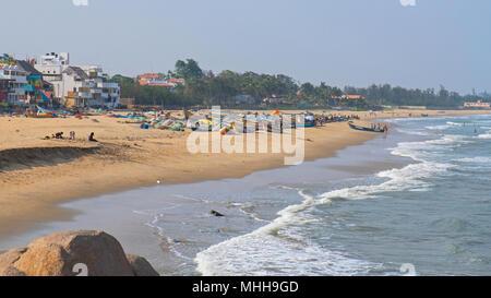 The beach at Mahabalipuram on the Coromandel coast in Tamil Nadu state overlooking the Bay of Bengal, with the local inshore fishing fleet ashore - Stock Photo