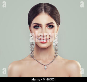 Young Perfect Woman with Jewelry Necklace and Silver Earrings. Smiling Model Girl - Stock Photo