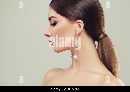 Portrait of Pretty Young Woman with Healthy Hair and Jewelry Silver Earrings, Female Face Closeup - Stock Photo