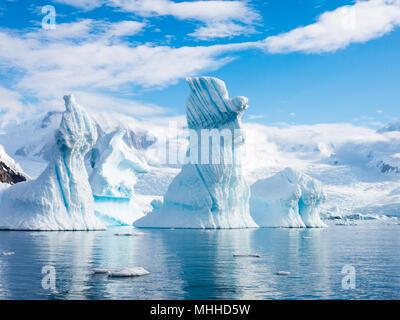 Pinnacle shaped icebergs floating in Andvord Bay near Neko Harbour, Antarctic Peninsula, Antarctica - Stock Photo