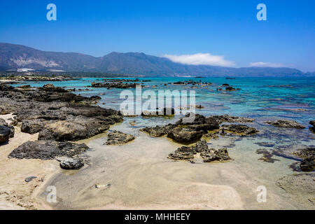 Sand and rock formations of Elafonisi Lagoon - Stock Photo