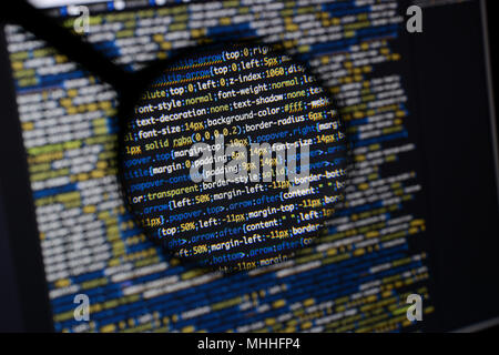 Real css code developing screen. Programing workflow abstract algorithm concept. Lines of css code visible under magnifying lens. - Stock Photo