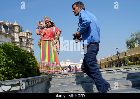 Tourists dressing up in traditional costumes for photographs at the City Palace. Udaipur, also known as the City of Lakes, The Venice of the East, is the historic capital of the kingdom of Mewar, Rajasthan. - Stock Photo