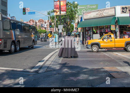 LOS ANGELES, USA - AUGUST 1, 2014 - people and movie mask on  LA Hollywood Walk of Fame - Stock Photo