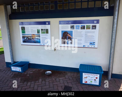 East Haven Toilet Block with Information signs and also a Visitor Friendly Dog Toy box and a Lost and Found Box beside the Public Toilets. Angus, Scot - Stock Photo