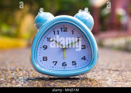 Alarm Clock on ground - Stock Photo