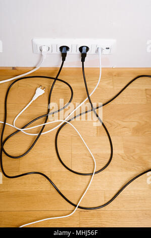 Electric and aerial outlet sockets, electric plugs and cables. - Stock Photo