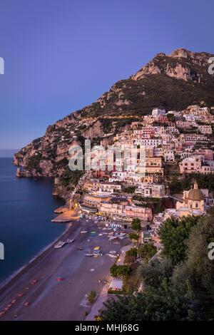 Morning twilight over Positano along the Amalfi Coast, Campania, Italy - Stock Photo