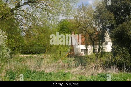 Willy Lott's Cottage from across the River Stour in Flatford, Suffolk, England - Stock Photo