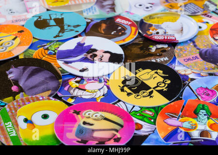 Colorful POGS of various cartoon characters - Stock Photo