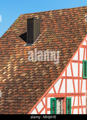 A partial view of a traditional house in Switzerland. - Stock Photo