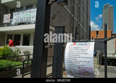 Residents of Burnhill House council tower block have put banners on their balconies complaining about plans to over-develop their neighbourhood with new luxury housing by Islington local authority in London,England,UK - Stock Photo