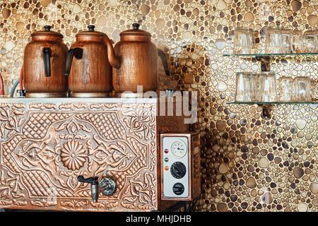 Tea brewing in wood fire.turkey. Water heating equipment in turkey - Stock Photo