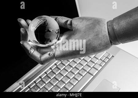 future technology, business and artificial intelligence concept Robot touching virtual earth hologram over laptop screen - Stock Photo