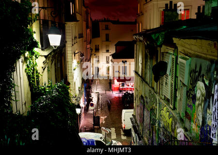 PARIS, FRANCE - 12th of OCTOBER 2012: Street of historical buildings and modern art graffiti on Montmartre by night. October 12th, 2012. Paris, France - Stock Photo
