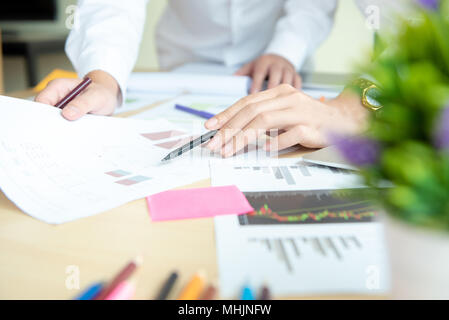 business group working check chart and paper data with laptop on desk in office - Stock Photo