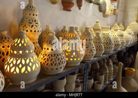 Traditional Bahraini pottery on a shelf in a shop for sale, Aali, Kingdom of Bahrain - Stock Photo