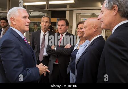 U.S. Vice President Mike Pence, left, thanks members of the NASA Jet Propulsion Laboratory leadership following a visit April 28, 2018 in Pasadena, California. Standing from left to right are: JPL Deputy Director Larry James, JPL Director Michael Watkins, JPL Distinguished Visiting Scientist and Spouse of UAG Chairman James Ellis, Elisabeth Pate-Cornell , UAG Chairman, James Ellis and California Institute of Technology President Thomas Rosenbaum. - Stock Photo
