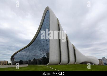 Heydar Aliyev center in Baku - Azerbaijan in a cloudy day - Stock Photo