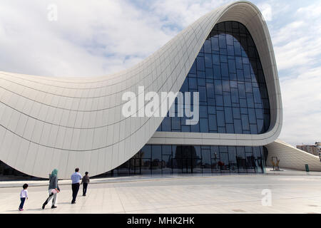 A BMW police car passing by Heydar Liyev center in Baku Azarbaijan - Stock Photo