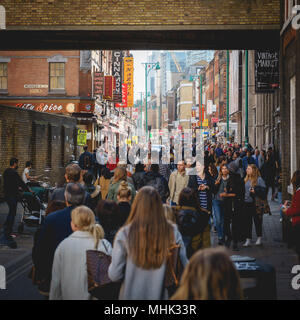 London (UK), September 2017. Brick Lane crowded of people. Square format. - Stock Photo