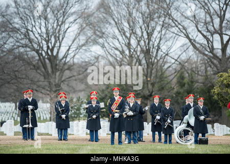 "The U.S. Army Band, ""Pershing's Own"", assist in conducting the full honors repatriation of U.S. Army Cpl. Dow F. Worden in Section 60 of Arlington National Cemetery, Arlington, Virginia, March 27, 2018.    Worden, 20, from Boardman, Oregon, went unaccounted in late September 1951 during the Korean War. A member of Company A, 1st Battalion, 9th Infantry Regiment, 2nd Infantry Division, Worden's company was in the vicinity of Hill 1024 in South Korea, conducting operations near an area known as Heartbreak Ridge, when the Chinese launched an attack. The company repelled and was relieved by the Re - Stock Photo"