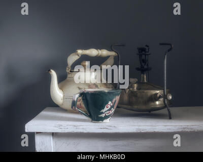 retro still life with a kettle and a stove. vintage. - Stock Photo