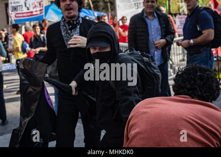 New York, New York, USA. 1st May, 2018. A black bloc protester fights a Trump counter protester at a May Day demonstration in Union Square. Credit: Taidgh Barron/ZUMA Wire/Alamy Live News - Stock Photo