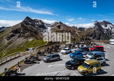 Grossglockner, Austria - August 7, 2017: Scenic view of Grossglockner Road from panoramic viewpoint against snowcapped mountains with clouds - Stock Photo