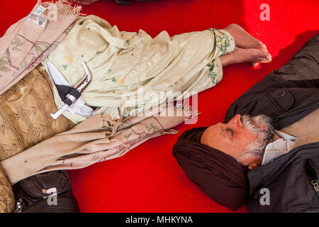 Pilgrims (Couple) sleeping, after a hard trip, inside of Golden temple, Amritsar, Punjab, India - Stock Photo