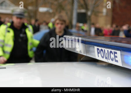 Knife crime, teenager arrested for carrying a knife, gang fight - Stock Photo