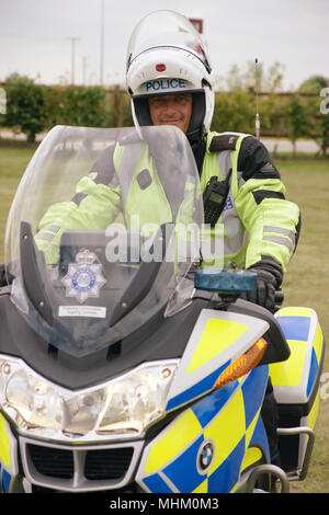 police officer on police motorcycle - Stock Photo