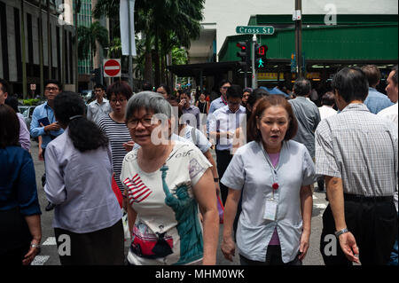 18.04.2018, Singapore, Republic of Singapore, Asia - Pedestrians are seen during lunch hour in Singapore's Central Business District. - Stock Photo