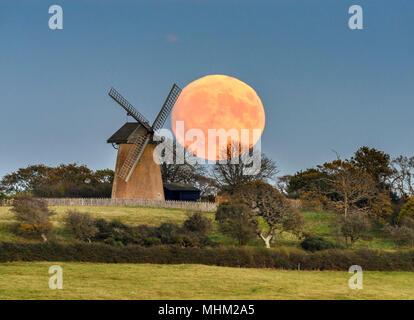 Rising Super Full Moon at Bembridge Windmill - Stock Photo