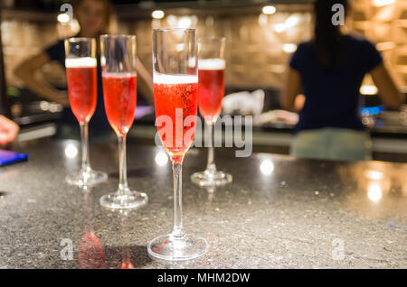 Glasses of champagne on house table, concept of party with friends. - Stock Photo