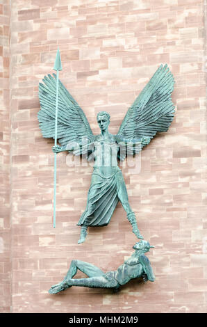 Sculpture by Jacob Epstein of St Michael's victory over the devil - Stock Photo