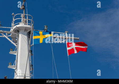 The flag of Sweden and Denmark on a ship mast. - Stock Photo
