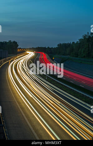 Colorful light trails of busy highway traffic on night, A1 Highway, Gliwice, Silesian Upland, Poland. - Stock Photo