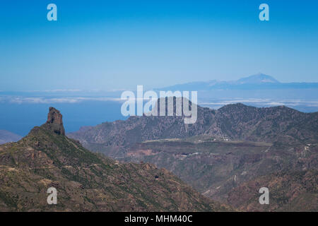 Spain, Canary islands, View of distant Tenerife and Mount Teide from mountains of Grand Canary - Stock Photo