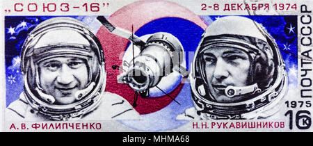 Minsk, Belarus - January 2, 2014: Image From Stamp Printed In USSR Shows Portraits Of Famous Russian Astronauts Filipchenko And Rukavishnikov. Inscrip - Stock Photo