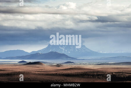 Beautiful landscape of mountain in Iceland with volcano in the background - Stock Photo
