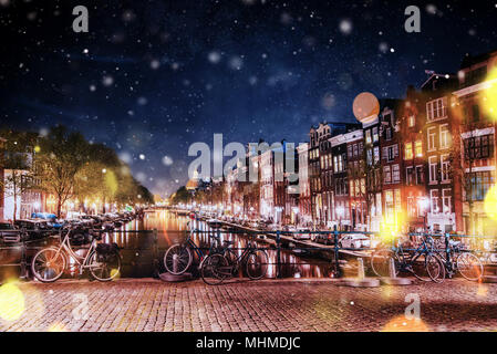 Bicycles Parked Along a Bridge Over the Canals of Amsterdam, Net - Stock Photo