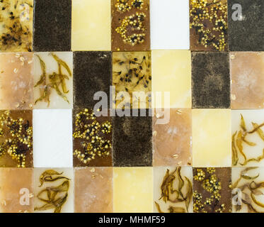 Yellow and brown assorted different handmade soap bars abstract - Stock Photo